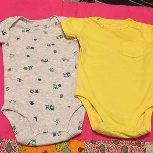 Two Carter's onesies